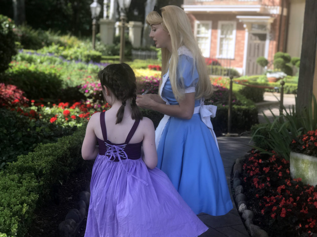 My oldest visiting with Alice in Wonderland at Epcot.